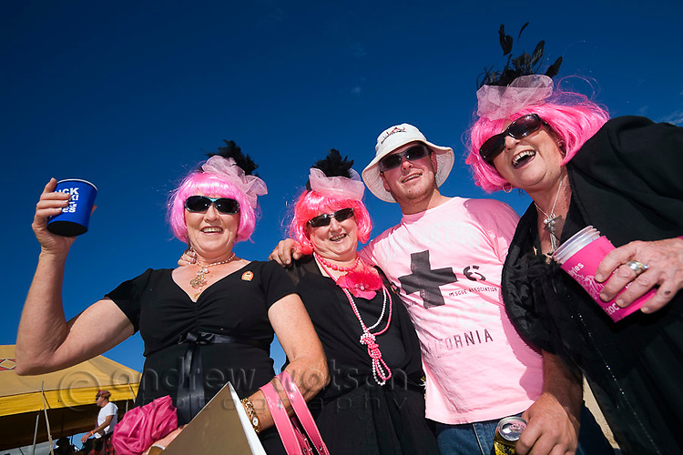 Race goers in costume dress at the Birdsville Races.  Every September the remote town of Birdsville comes alive for the most famous horse racing festival in outback Australia.  Birdsville, Queensland, AUSTRALIA.  © Andrew Watson / Axiom