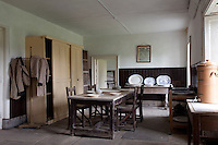 One of the rooms adjoining the kitchen was once a bustling hub of activity, and now echoes with emptiness