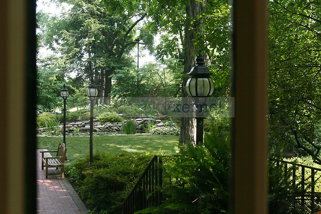 A view of the pond behind Maxwell Place from inside, in a room that was once a patio.