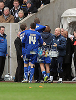 ATTENTION SPORTS PICTURE DESK<br /> Pictured: Mobbed by team mates, Craig Bellamy of Cardiff celebrating his goal.<br /> Re: npower Championship Swansea City FC v Cardiff City FC at the Liberty Stadium, south Wales. Sunday 06 February 2011