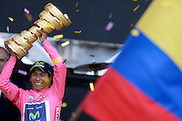 TRIESTE - ITALIA. 01-06-2014. Nairo Alexander  Quintana Rojas -Col- (Movistar) levanta el trofeo para celebrar como campeón general de la versión 97 del Giro de Italia hoy 22 de mayo de 2014. / Nairo Alexander  Quintana Rojas -Col- (Movistar) lifts the trophy to celebrate as champion of the 97th version of Giro d'Italia today May 22th 2014 Photo: VizzorImage/ Fabio Ferrari / LaPresse<br /> VizzorImage PROVIDES THE ACCESS TO THIS PHOTOGRAPH ONLY AS A PRESS AND EDITORIAL SERVICE AND NOT IS THE OWNER OF COPYRIGHT; ANOTHER USE HAVE ADDITIONAL PERMITS AND IS  REPONSABILITY OF THE END USER
