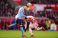 Javier Manquillo of Newcastle United wins a header over Xherdan Shaqiri of Stoke during the EPL - Premier League match between Stoke City and Newcastle United at the Britannia Stadium, Stoke-on-Trent, England on 1 January 2018. Photo by Bradley Collyer / PRiME Media Images.