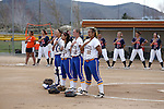 Western Nevada and Snow College players listen to the National Anthem before a game at Edmonds Sports Complex in Carson City, Nev., on Friday, March 20, 2015. <br /> Photo by Cathleen Allison