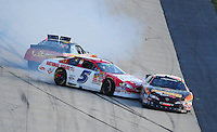 Sept. 20, 2008; Dover, DE, USA; Nascar Nationwide Series driver Landon Cassill (5) and Steve Wallace (66) crash as Joey Logano (right) goes low to avoid the incident during the Camping World RV 200 at Dover International Speedway. Mandatory Credit: Mark J. Rebilas-