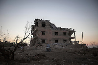 In this Sunday, Sep. 29, 2013 photo, a destroyed house building is seen in Telata village, an standoff frontline located at the top of a mountain in the Idlib province countryside of Syria. (AP Photo)
