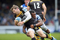 Elliot Daly is tackled by Semesa Rokoduguni. Amlin Challenge Cup semi-final, between London Wasps and Bath Rugby on April 27, 2014 at Adams Park in High Wycombe, England. Photo by: Patrick Khachfe / Onside Images