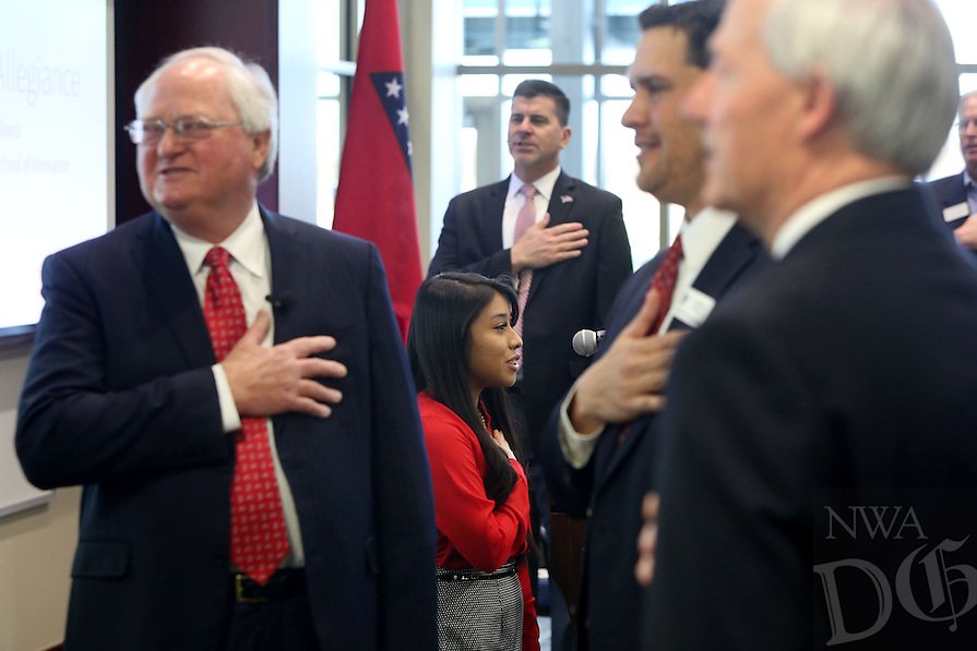 NWA Democrat-Gazette/DAVID GOTTSCHALK   Yulissa (cq) Rivera, a sophomore and student council president at Don Tyson School of Innovation, leads the Pledge of Allegiance Thursday, February 9, 2017, from Cindy Lyons, a math teacher, as they meet John Tyson, chairman of the board for Tyson Foods, during a dedication ceremony for Springdale's new Don Tyson School of Innovation campus. The school is named after Donald Tyson former chairman and chief executive officer of Tyson Foods. Half of the campus opened in August, with construction wrapping up on the other half in time for this semester.