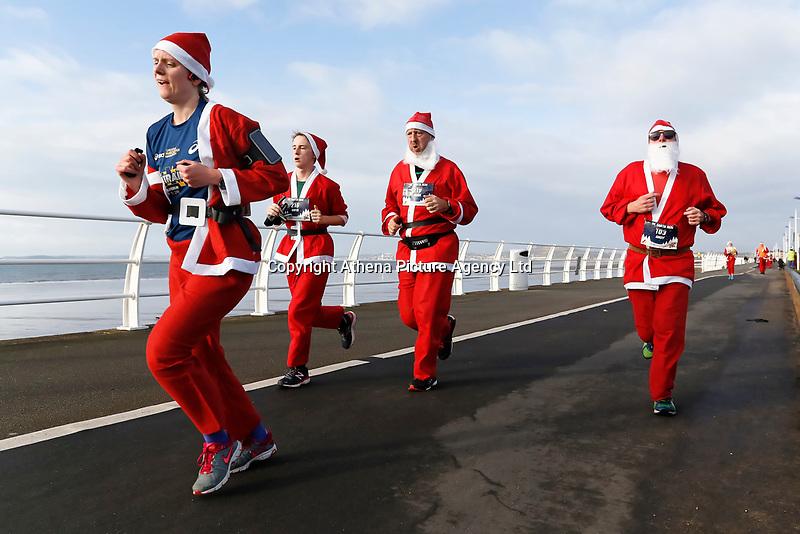 Pictured: Runners in Santa Claus fancy dress take part in this year's run in Aberavon, Wales, UK. Saturday 16 December 2017<br /> Re: 500 people have taken part in Run4All Santa 5km Run on Aberavon Promenade near Port Talbot, Wales, UK.