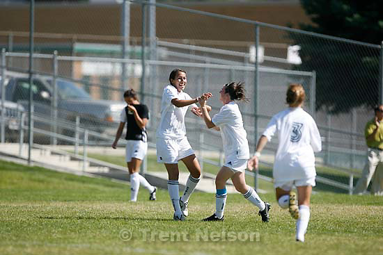 Salt Lake City - Olympus's Marci Castillo celebrates her first half goal. Running in at right is Lisa Christensen. Olympus beats Highland high school girls soccer 2-1 Thursday, August 27 2009. .