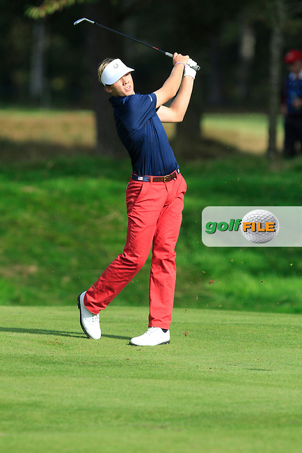 Sam Burns (USA) on the 9th hole of the Mixed Fourballs, puts to go two up during the 2014 JUNIOR RYDER CUP at the Blairgowrie Golf Club, Perthshire, Scotland. <br /> Picture:  Thos Caffrey / www.golffile.ie