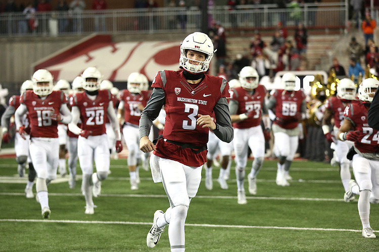 Tyler Hilinski (3), Washington State University quarterback, helps lead the team out on to the field prior to the Cougars Pac-12 conference game against the Colorado Buffaloes at Martin Stadium in Pullman, Washington, on November 21, 2015.  The Cougar defense kept Colorado out of the end zone all night, as WSU soundly defeated Colorado, 27-3.