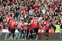 Brentford players congratulate Neal Maupay after scoring Brentford's second goal during Brentford vs Wigan Athletic, Sky Bet EFL Championship Football at Griffin Park on 15th September 2018