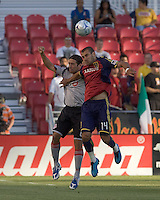 Toronto FC midfielder/forward Pablo Vitti (8) and Real Salt Lake midfielder/defender Robbie Russell (3) battle for head ball. Salt Lake Real defeated Toronto FC, 3-0, at Rio Tinto Stadium on June 27, 2009.