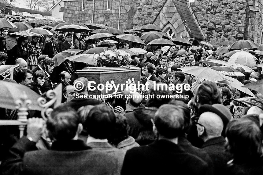 Funeral of one of the Kingsmill Massacre victims in which 10 Protestant textile workers were shot dead by the Republican Action Force, generally accepted as a covername for the Provisional IRA. Ref: 197601080024B.<br /> <br /> Copyright Image from Victor Patterson, 54 Dorchester Park, <br /> Belfast, UK, BT9 6RJ<br /> <br /> t1: +44 28 9066 1296 (from Rep of Ireland 048 9066 1296)<br /> t2: +44 28 9002 2446 (from Rep of Ireland 048 9002 2446)<br /> m: +44 7802 353836<br /> <br /> e1: victorpatterson@me.com<br /> e2: victorpatterson@gmail.com<br /> <br /> www.victorpatterson.com<br /> <br /> Please see my Terms and Conditions of Use at www.victorpatterson.com. It is IMPORTANT that you familiarise yourself with them.<br /> <br /> Images used on the Internet must be visibly watermarked i.e. &copy; Victor Patterson within the body of the image and copyright metadata must not be deleted. Images used on the Internet have a size restriction of 4kbs and will be chargeable at current NUJ rates unless agreed otherwise.<br /> <br /> This image is only available for the use of the download recipient i.e. television station, newspaper, magazine, book publisher, etc, and must not be passed on to any third party. It is also downloaded on condition that each and every usage is notified within 7 days to victorpatterson@me.com<br /> <br /> The right of Victor Patterson to be identified as the author is asserted in accordance with The Copyright Designs And Patents Act (1988).