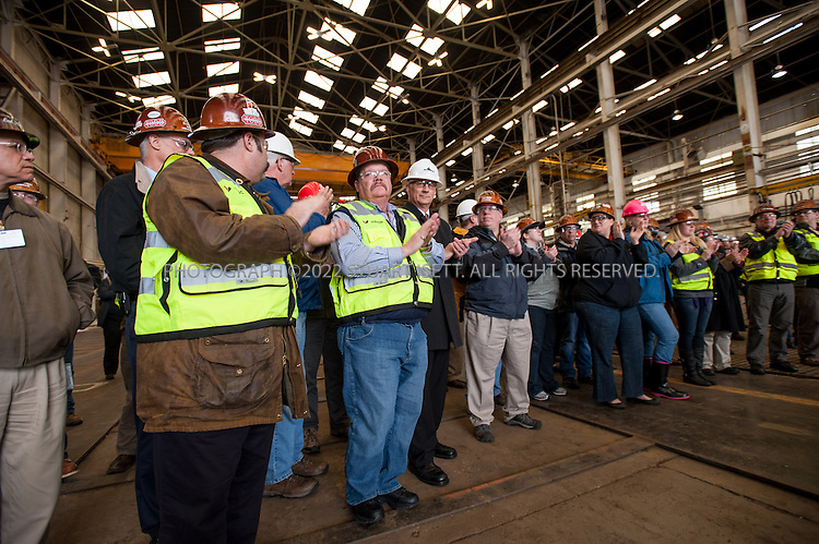 3/29/2012--Seattle, WA, USA<br /> <br /> The first arc welds on the keel of Washington&rsquo;s new 144-car ferry were made today by the leaders of the state Legislature transportation committees, Sen. Mary Margaret Haugen of Camano Island and Rep. Judy Clibborn of Mercer Island.<br /> <br /> Here Chris Morgan, VP of US Fab, starts the ceremony.<br /> <br /> The keel laying, the maritime equivalent of placing a cornerstone, is a traditional milestone in ship building. Haugen and Clibborn marked the formal start of construction for a new class of ferries designed to carry up to 144 cars and 1,500 passengers across the waters of Puget Sound.<br /> <br /> Work on this first vessel will produce an estimated 200 family-wage jobs at US Fab, plus 350 additional jobs at subcontractors and other shipyards in the region.<br /> <br /> WSF estimates the new 144-car ferry will start service in early 2014. Cost of construction is $115 million, and the total cost of the vessel is $147 million, which includes owner-furnished equipment, construction management and contingencies.<br /> <br /> Photograph by Stuart Isett/Vigor