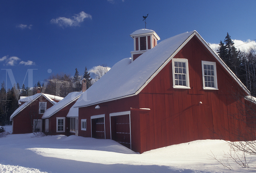 Vermont, VT, Snow-covered red house in winter in the town of Peacham.