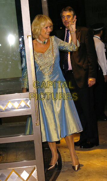 HRH CAMILLA, DUCHESS OF CORNWALL.At The Sir John Betjeman Gala,.Prince Of Wales Theatre, Coventry Street, London, .September 10th 2006..full length roayl royalty blue two tone dress gold silk satin shiny pearl choker necklace hand waving.Ref: CAN.www.capitalpictures.com.sales@capitalpictures.com.©Can Nguyen/Capital Pictures