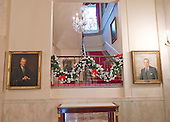 """The 2016 White House Christmas decorations are previewed for the press at the White House in Washington, DC on Tuesday, November 29, 2016. Pictured are the decorations on the landing of the Grand Staircase leading to the Residence. The first lady's office released the following statement to describe those decorations, """"This year's holiday theme, 'The Gift of the Holidays,' reflects on not only the joy of giving and receiving, but also the true gifts of life, such as service, friends and family, education, and good health, as we celebrate the holiday season.""""<br /> Credit: Ron Sachs / CNP"""