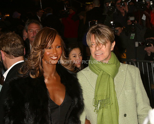 "David Bowie and Iman arriving at the premiere of ""Gangs of New York."" New York, December 9, 2002. Please byline: Alecsey Boldeskul/NY Photo Press.   ..*PAY-PER-USE*      ....NY Photo Press:  ..phone (646) 267-6913;   ..e-mail: info@nyphotopress.com"