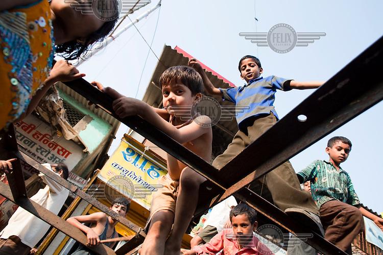 Children playing in the alleyways of Dharavi slum.