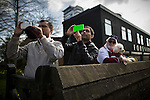 © Joel Goodman - 07973 332324 . 13/03/2016 . Manchester , UK . People watch the parade and record it on their smartphones . The St Patrick's Day Parade , celebrating the Irish Community , through Manchester City Centre , in the Spring sunshine . Photo credit : Joel Goodman