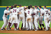 The Mississippi State Bulldogs celebrate their walk-off win over the Houston Cougars in game six of the 2018 Shriners Hospitals for Children College Classic at Minute Maid Park on March 3, 2018 in Houston, Texas. The Bulldogs defeated the Cougars 3-2 in 12 innings. (Brian Westerholt/Four Seam Images)
