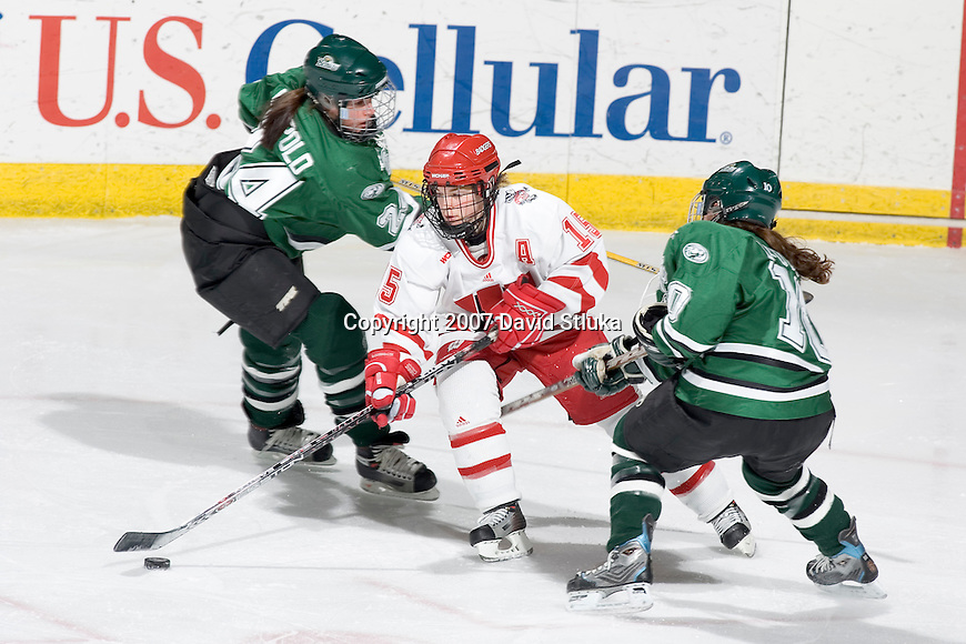 MADISON, WI - FEBRUARY 16: Sara Bauer #15 of the Wisconsin Badgers women's hockey team handles the puck against the Bemidji State Beavers at the Kohl Center on February 16, 2007 in Madison, Wisconsin. The Badgers beat the Beavers 2-0. (Photo by David Stluka)