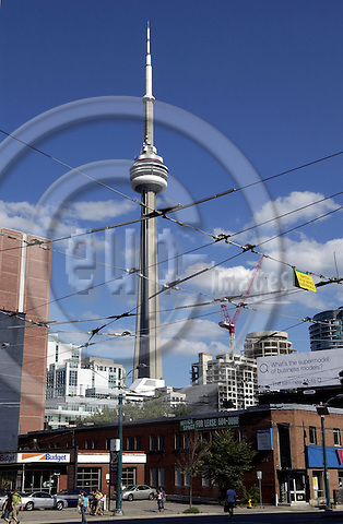 Toronto, Ontario, Canada - 07 August 2006 -- CN Tower and streetcar /tramway power cables -- landmark, infrastructure -- Photo: Horst Wagner / eup-images