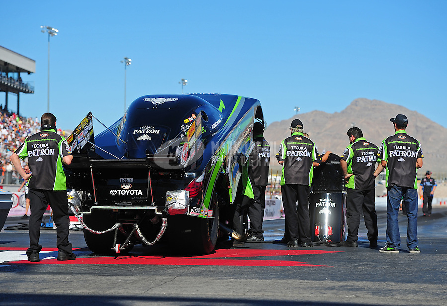 Oct. 30, 2011; Las Vegas, NV, USA: NHRA crew members for funny car driver Alexis DeJoria during the Big O Tires Nationals at The Strip at Las Vegas Motor Speedway. Mandatory Credit: Mark J. Rebilas-