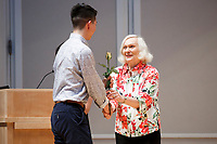 USA International Harp Competition Founder and Artistic Director Susann McDonald greets a contestant during the opening ceremony of the 11th USA International Harp Competition at Indiana University in Bloomington, Indiana on Wednesday, July 3, 2019. (Photo by James Brosher)