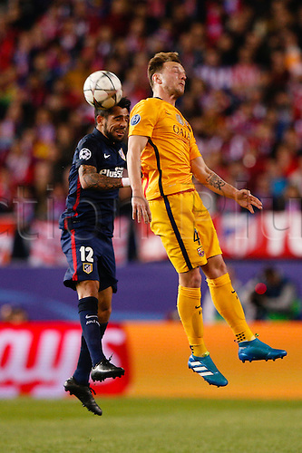 13.04.2016. Madrid, Spain.  Augusto Fernandez (12) Atletico de Madrid and Ivan Rakitic (4) FC Barcelona. UCL Champions League between Atletico de Madrid and FC Barcelona at the Vicente Calderon stadium in Madrid, Spain, April 13, 2016 .