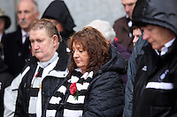 Pictured: Swansea supporters observe a minute's silence after the plaque unveiling Sunday 09 November 2014<br />