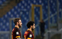 Calcio, Serie A: Roma vs Milan. Roma, stadio Olimpico, 9 gennaio 2016.<br /> Roma's Daniele De Rossi, left, and Mohamed Salah leave the pitch at the end of the Italian Serie A football match between Roma and Milan at Rome's Olympic stadium, 9 January 2016. The game ended 1-1.<br /> UPDATE IMAGES PRESS/Riccardo De Luca
