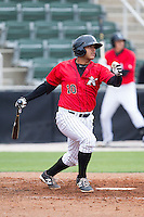 Omar Narvaez (10) of the Kannapolis Intimidators follows through on his swing against the Greenville Drive at CMC-Northeast Stadium on April 6, 2014 in Kannapolis, North Carolina.  The Intimidators defeated the Drive 8-5.  (Brian Westerholt/Four Seam Images)