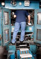 Gary Hoyen (cq) prepares a printing press during a press run at the Dallas Morning News printing press in Plano, Texas, US, Thursday, Dec., 17, 2009. ..MATT NAGER/ BLOOMBERG NEWS