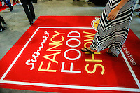 NEW YORK, NY JUNE 27: A woman walks by a carpet as she attends the Annual Summer Fancy Food Show at the Javits Center in Manhattan on June 27, 2016 in New York City. (Photo by VIEWpress)