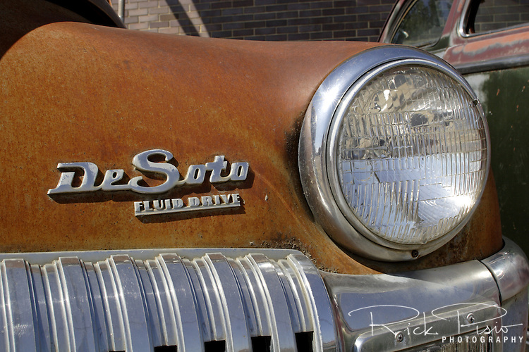 Grill and headlight of a DeSoto automobile.