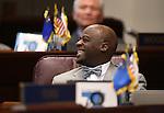 Nevada Sen. Kelvin Atkinson, D-North Las Vegas, works on the Senate floor at the Legislative Building in Carson City, Nev., on Thursday, Feb. 12, 2015. <br /> Photo by Cathleen Allison