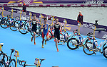 LONDON, ENGLAND - AUGUST 7:  Alistair Brownlee of Great Britain, Javier Gomez of Spain, and Johnathan Brownlee of Great Britain runs during the Men's Triathlon Final, Day 12 of the London 2012 Olympic Games on August 7, 2012 at Hyde Park in London, England. (Photo by Donald Miralle)