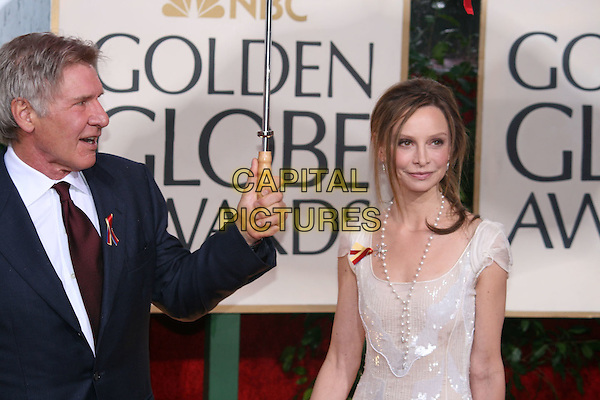 HARRISON FORD & CALISTA FLOCKHART.Arrivals at the 67th Golden Globe Awards, he Beverly Hilton Hotel, Beverly Hills, California, USA, .January 17th, 2010..globes half length couple grey gray suit red maroon tie umbrella raining white dress pearl necklace sequined sequin cream pattern profile .CAP/AW/MAZ .©Maz/Weber/Capital Pictures.