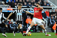 Matt Ritchie of Newcastle United battles with Nemanja Matic of Manchester United during Newcastle United vs Manchester United, Premier League Football at St. James' Park on 11th February 2018