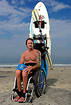 ENCINITAS, CA - MARCH 7: Paraplegic surfer and athlete Jeremy McGhee drops into a wave at Cardiff Reef on July 3, 2013 in Encinitas, California. McGhee lost use of all his muscles and feeling below his sternum after a motorcycle crash several years ago, but continues to live an adventurous lifestyle of surfing, skiing, swimming and paddling while also giving motivational public speeches. A local shaper Jeff Grygera made him a special board in which Jeremy's legs and lower bag are strapped in and supported, while he to paddles into waves with a kayak paddle and disengages from board and swim with his arms if he flips.