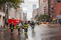 FDNY firefighters respond to a watermain break  in the Chelsea neighborhood of New York on Wednesday, October 12, 2016. The watermain break caused water to gush but it was mostly contained to the street safely running into storm drains. (© Richard B. Levine)