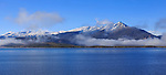 Cloud shrouded mountain peaks over Dillon Reservoir at Silverthorne Colorado in the colorado rockies during autumn, USA