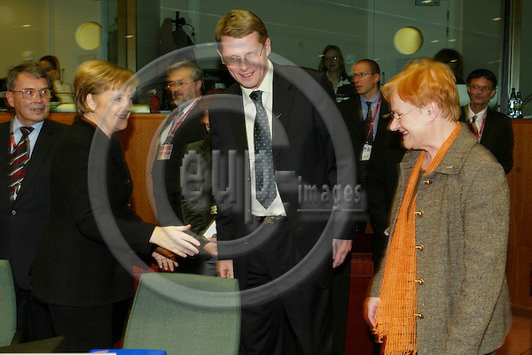 BRUSSELS - BELGIUM - 15 DECEMBER 2005 -- EU SUMMIT --Angela MERKEL Federal Chancellor of Germanym Matti VANHANEN, Prime Minister of Finland and Tarja HALONEN, President of Finland.  PHOTO: ERIK LUNTANG / EUP-IMAGES