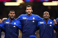 Noa Nakaitaci, Yoann Maestri and Eddy Ben Arous of France sing their national anthem. Rugby World Cup Pool D match between France and Ireland on October 11, 2015 at the Millennium Stadium in Cardiff, Wales. Photo by: Patrick Khachfe / Onside Images