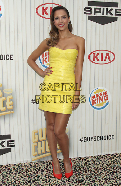 Jessica Alba<br /> 2013 Spike TV Guys Choice Awards held at Sony Pictures Studios, Culver City, California, USA, <br /> 8th June 2013.<br /> full length shiny leather yellow strapless dress red shoes cleavage bustier tanned croc animal patterned hand on hip<br /> CAP/ADM/RE<br /> &copy;Russ Elliot/AdMedia/Capital Pictures