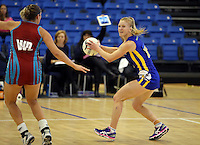 29.09.2014 Dunedin's Shannon Francois in action during the Dunedin v Kapi Mana match duing the Lion Foundation Netball Champs at the Trusts Stadium in Auckland. Mandatory Photo Credit ©Michael Bradley.