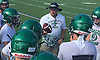 Mike Bush, Farmingdale varsity football assistant coach, talks to players during practice at Farmingdale High School on Tuesday, Aug. 16, 2016.