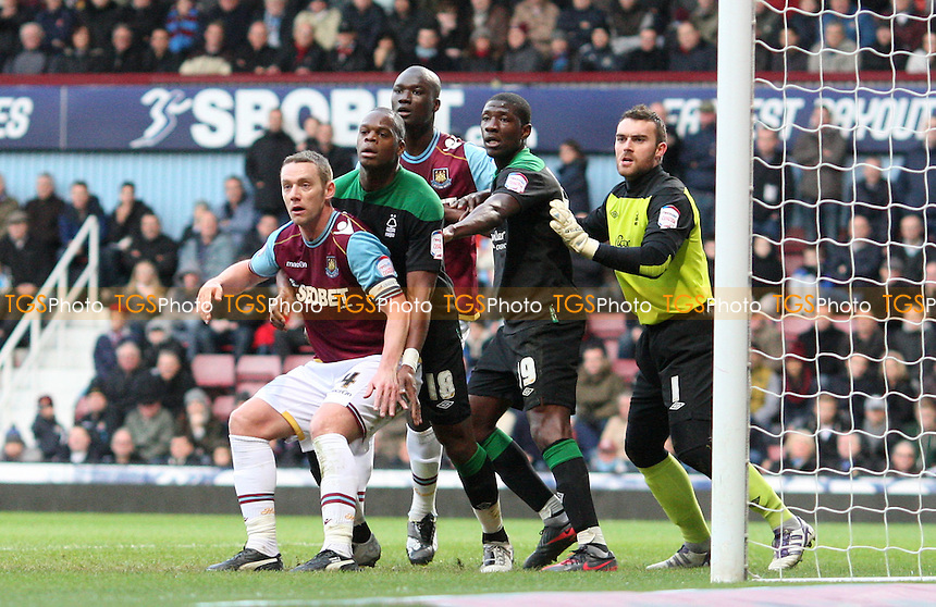 Kevin Nolan and Papa Bouba Diop of West Ham make their presence felt in the Nottingham Forest penalty area - West Ham United vs Nottingham Forest, npower Championship at Upton Park, West Ham - 21/01/12- MANDATORY CREDIT: Rob Newell/TGSPHOTO - Self billing applies where appropriate - 0845 094 6026 - contact@tgsphoto.co.uk - NO UNPAID USE..